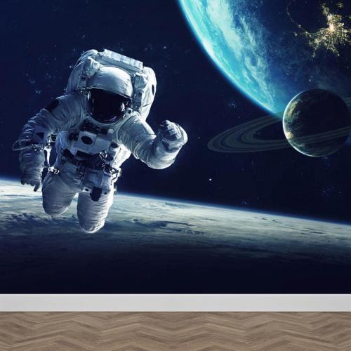 Carta da parati Astronauta vicino terra