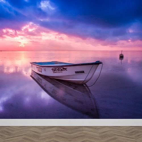 Fotobehang bootje in zee